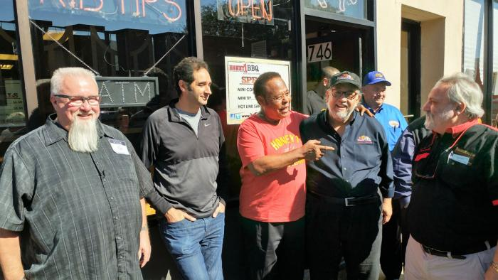 Legendary Chicago Pitmasters in front of Honey 1 BBQ