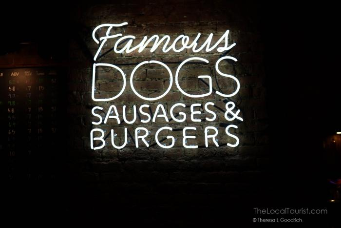 Famous dogs, sausages, and burgers sign at Dog Haus Chicago