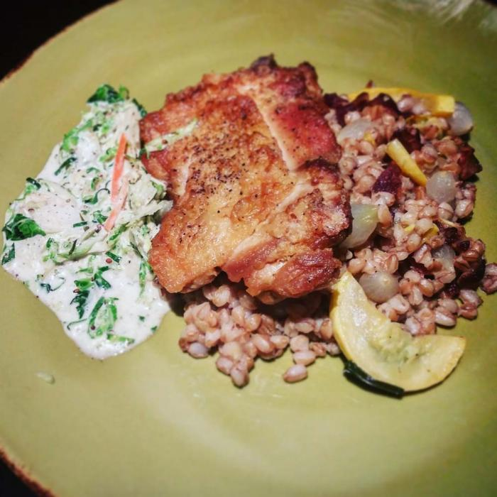 The Ashburn: seared chicken thigh with Farro pilaf of squash, bacon, pearl onions, and lemon-tarragon coleslaw.