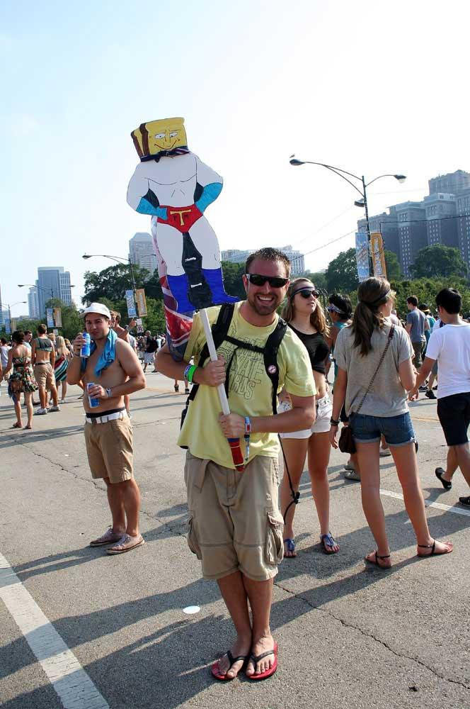 Carrying fun signs is a unique way for friends to find each other at Lollapalooza