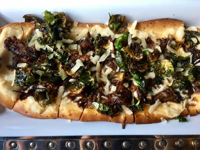 Matilda Flatbread: Short & Sprout: roasted garlic béchamel, braised short rib, and crispy brussels sprout leaves
