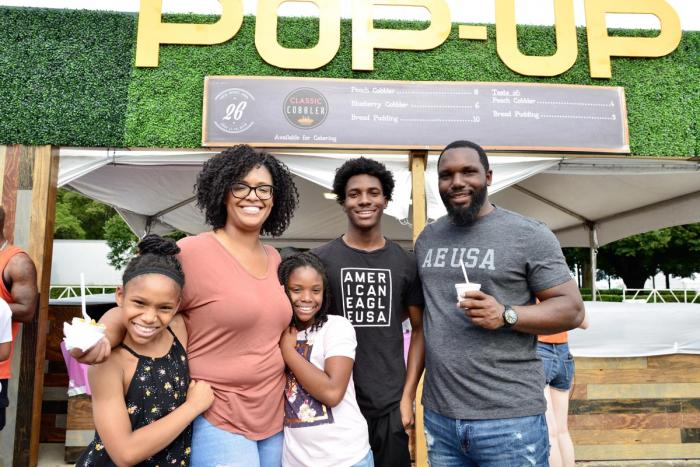 Family in front of pop-up restaurants at Taste of Chicago