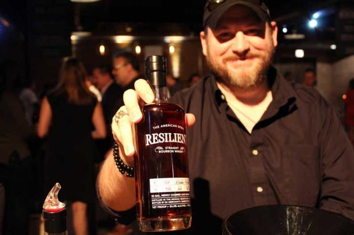 Colby Turner of BC Merchants and a bottle of Resilient Bourbon
