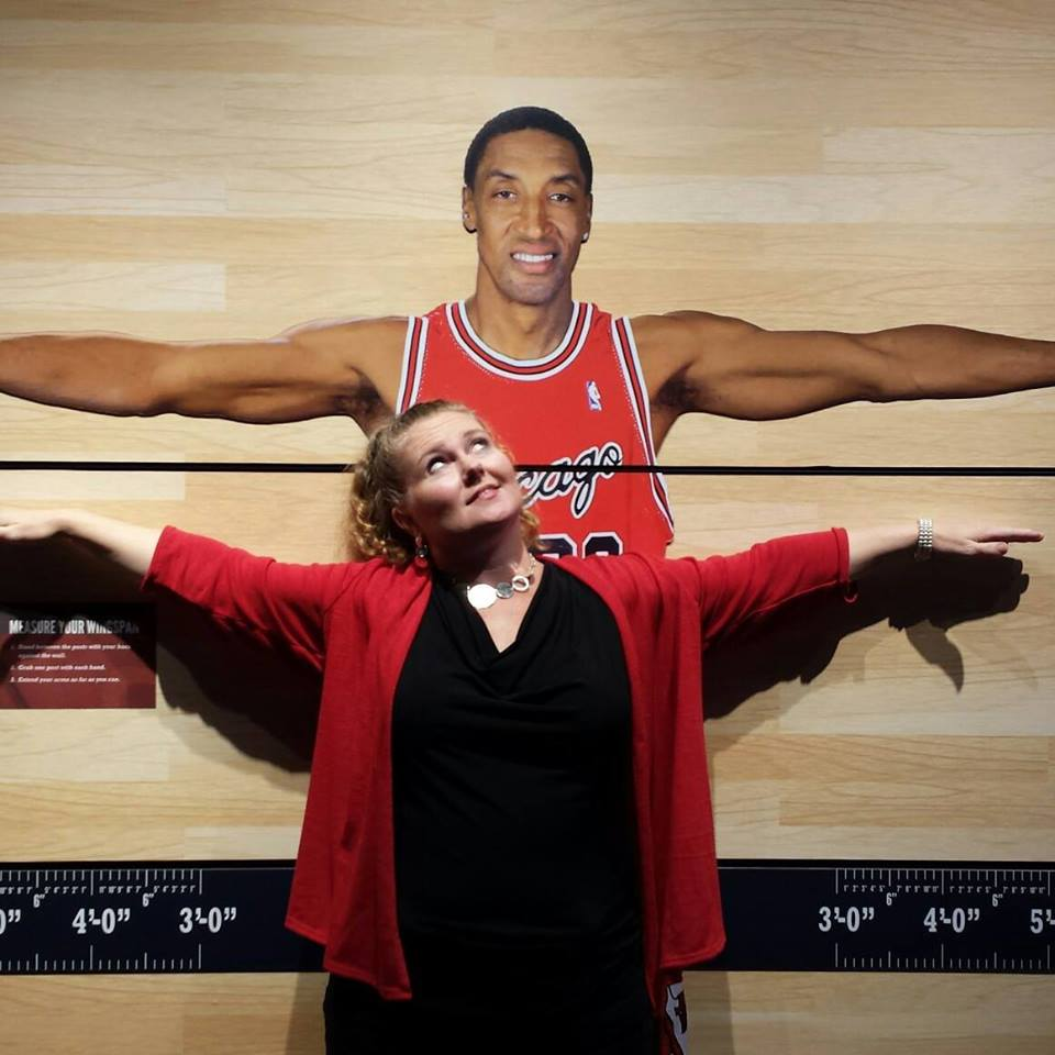 Theresa testing her wing span against Scottie Pippin at the Chicago Sports Museum