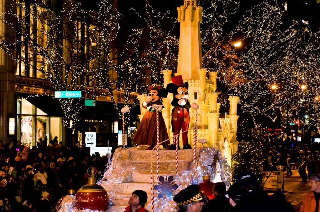 Micky Mouse and Minnie Mouse are Grand Marshals of the Magnificent Mile Lights Festival parade in Chicago