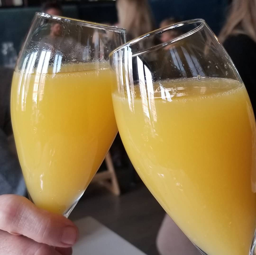 Bottomless Mimosas from the brunch menu at Le Sud in Chicago's Roscoe Village