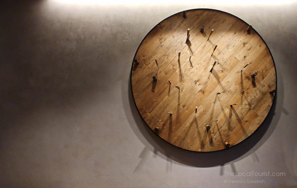Knives impaled in giant spinning wooden disc in the lobby of Hotel Julian