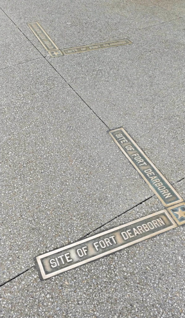 Fort Dearborn brass markers embedded in sidewalk mark the location of the historic fort