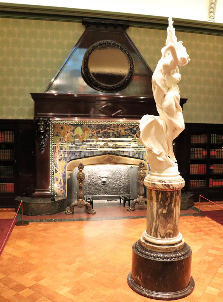 monumental fireplace with an iridescent tile surround