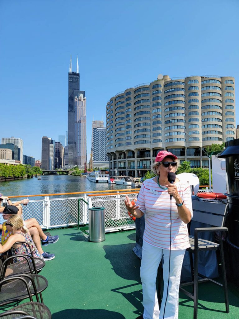 A Chicago Architecture Center docent leading a tour on the Chicago River