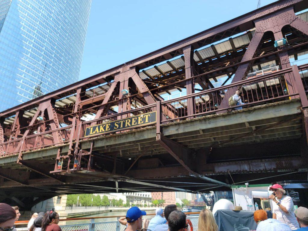 The Chicago Architecture Foundation Center River Cruise passes under Lake Street Bridge